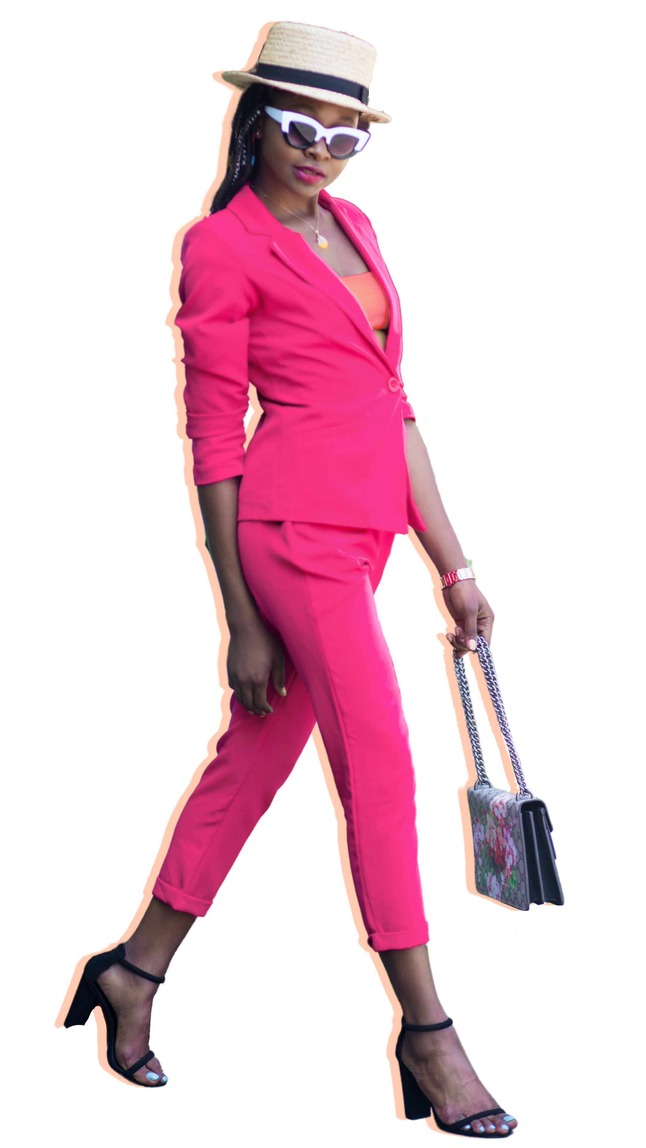 Cut out of concrete cowgirl walking in pink pants suit