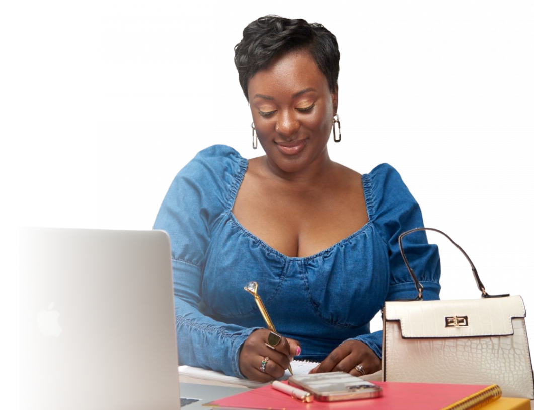 Gabby of Strut to Success at desk writing with a diamond pen